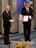 Nobel Committee Chairman Thorbjorn Jagland presents President Barack Obama with the Nobel Prize medal and diploma during the Nobel Peace Prize ceremony in Raadhuset Main Hall at Oslo City Hall in Oslo, Norway, Dec. 10, 2009.