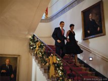 President Barack Obama and First Lady Michelle Obama descend the Grand Staircase of White House to attend a holiday party, Dec. 13, 2009.