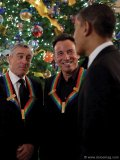 President Barack Obama greets Robert DeNiro and Bruce Springsteen at a reception for the Kennedy Center Honors recipients in the Blue Room of the White House, Dec. 6, 2009.