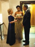 Secretary of State Hillary Clinton confers with President Barack Obama and First Lady Michelle Obama prior to a reception at the White House for Prime Minister Manmohan Singh of India and his wife, Mrs Gursharan Kaur, Nov. 24, 2009.