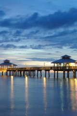 Three miles of immaculate beach shimmers as it stretches along Florida's Paradise Coast.