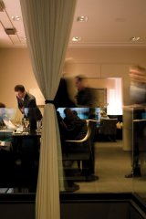Alinea restaurant in Chicago offers a chic atmosphere with modern décor.