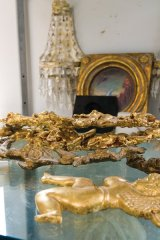 Vaclav Vaca adds his personal touch of gold leaf finishes to regal home accessories.
