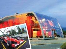 Italian designer Massimo Iosa Ghini conceptualized this striking glass gallery for Ferrari's Factory Store in Serravalle Scrivia, Italy.