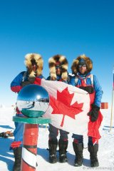 South Pole Quest, 2009. Zahab, Vallely and Arctic explorer Richard Weber huddle together after completing their 33-day expedition from Hercules Inlet, Antarctica to the Geographic South Pole.