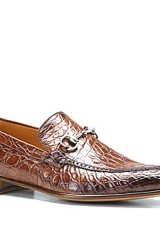 Rough brown crocodile skin adds a hint of edge to these swanky Gucci moccasins, while a silver horsebit balances the look with debonair detailing.