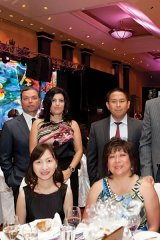 DFC Auto Group members and guests, including Michelle Zerillo-Sosa, Dolce Publishing Inc. co-founder, husband, Sergio Sosa, Peter-James Gregory, president at Atlas Tire Wholesale Inc., and wife, Deborah Gregory (centre)