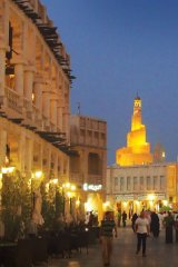 Get a glimpse of the  Fanar building from the Souk Waqif
