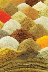 The scent of spices fills the air in a shop at the Souk Waqif