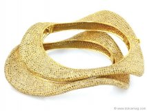 Gold bracelet from Bavna Jewelers.