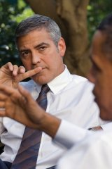 President Barack Obama talks about Sudan with actor George Clooney during a meeting outside the Oval Office, Oct. 12, 2010.