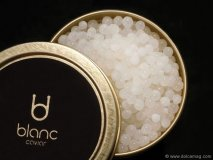 """Dubbed the """"Pearls of Aphrodite,"""" Blanc Caviar is a novel and pristine reimagining of a classic hors d'oeuvre. The tin, designed by Spanish studio Neosbrand, encapsulates the precious elegance of its contents with polish and poise. www.blancgastronomy.com"""