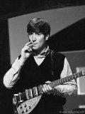 John Lennon takes a break during rehearsal with the Beatles, Twickenham Studios,  London, 1963
