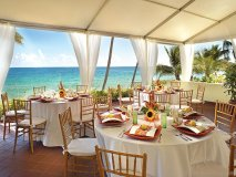 the pelican grand hosts a number of banquets and destination weddings mere steps from the beach
