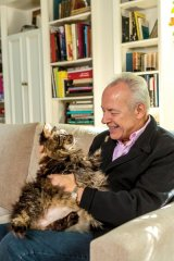 Petty and his cat, a Maine coon named Eddie