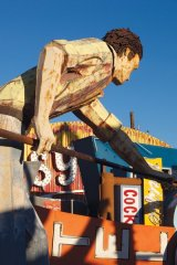 "The famous ""Pool Player"" from Doc n Eddy's Pool Hall can be found in the Neon Boneyard"