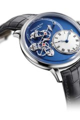 7. TIME'S UP: Arnold & Son's limited edition Dial Side True Beat timepiece is an instant staple item with the mechanical artistry of its moon-over-calm-seas face held in an 18-carat white gold case. www.arnoldandson.com