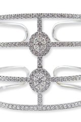 8. GLAM-CUFFED: Toronto jewelry designer Mark Lash ends your search for that perfect outfit centrepiece for those holiday parties: this geometrically flawless white gold and diamond cuff. www.marklash.com