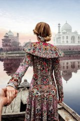 Dressed in an ornate gown, Nataly looks at the Taj Mahal in Agra, Uttar Pradesh, India