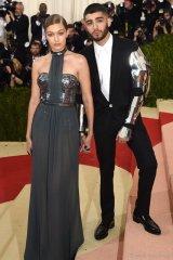 Gigi Hadid in Tommy Hilfiger and Zayn Malik in Versace