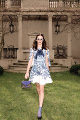 Be adventure-ready with a floral gown-and-jacket set / Gown and jacket: Karen Millen; shoes: Saint Laurent; bracelet and bag: A Cuckoo Moment; sunglasses: Swatch