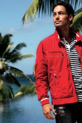 Sharpen your style by pairing a red nylon jacket from Paul & Sharks with a striped cotton polo and start swimming with the big fish.