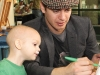 Hayden Christensen with a child from SickKids.