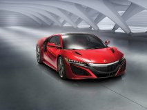 The all-new Acura NSX sports a hybrid power system that combines a twin-turbo V-6 with three electric motors to generate over 550 horsepower