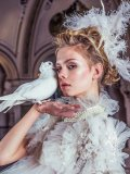 Dress by Anna Kania Couture; jacket by Honeymoon; pearl necklace by Galerie Pearls Collection by Karin van Noort; feather headpiece by Honeymoon