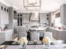 The designer selected Villa Kitchens and esteemed local company  Artizan Interior & Exterior Finishings Inc.  to create eye-catching ceilings  and mouldings