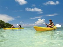 Kayaking the pristine tropical waters is a popular island activity