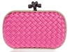 PINK LADY With just enough space for the essentials, this satin Bottega Veneta clutch adds  an elegant touch to any outfit. Pair it with a skirt  and ballet flats for your next dinner date. www.net-a-porter.com