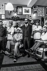 The Schorem crew in their men-only barbershop in the heart of Rotterdam, Holland