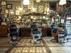 The shop features plenty of antiques and paraphernalia, from the chairs to the photos, to give it that authentic feel. Clients have been known to wait in line for four to five hours for a cut and shave