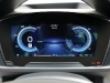Two digital screens mount the dashboard to relay vehicle performance and access  the infotainment system.