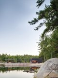 Nestled on the quiet shore of Georgian Bay in the Archipelago, this design reimagines the traditional boathouse with modern esthetic elements  and functionality