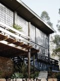 Button's home features reclaimed factory windows, stone accents, brick walls and rough wooden floors