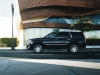 Character lines cut along the side of the 2015 Escalade, elongating its already massive profile