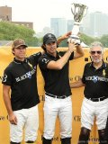 Black Watch celebrates a winning tournament with captain Nacho Figueras at the Veuve Clicquot Manhattan Polo Classic.