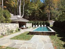 The Reflection Pool and outdoor fireplace heighten romantic evenings in the lush Westchester scenery.