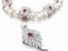 "La Peregrina: The top lot of the sale was the legendary 16th century pearl, set in a diamond and ruby necklace Elizabeth Taylor commissioned from Cartier. It sold for $11,842,500, setting two world auction records. A gift from Richard Burton, who purchased it for $37,000 at auction in 1969, this remarkable natural pearl measures 203 grains in size, equivalent to 50 carats. In her book, My Love Affair with Jewelry, Taylor describes her panic when she noticed the pearl was missing one day. After searching all over the bedroom, she noticed one of her dogs playing with something: ""I just casually opened the puppy's mouth and inside was the most perfect pearl in the world. It was – thank God – not scratched."""
