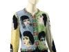 vA Versace Beaded Evening Jacket, 'The Face,': Circa 1992 realized $128,500. This jacket is beaded with rhinestone portraits of Elizabeth Taylor in her most famous roles, including Cleopatra. She wore this jacket when she spoke at The Freddie Mercury Tribute Concert for AIDS Awareness, which featured a performance by the remaining members of the band Queen in 1992 at London's Wembley Stadium.