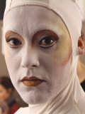 Dramatic makeup is essential so artists can be seen from afar.