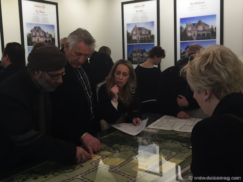 Guests examine the available lots at Copperwood Kleinburg