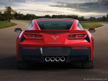 The 2014 Chevrolet Corvette Stingray's body has received a hard, sharp makeover. The circular tail lights, staples of past Corvettes, are replaced with Camaro-esque squares, while the four adjacent exhaust tips are gathered more tightly together