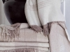 Indulge in a faux fur throw from St. Pierre or a Marzotto cashmere blanket for instant comfort and sophistication
