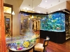A calming aquarium wet bar combines innovation and tropical design in Frank McKinney's latest feat.