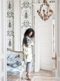Tricia Guild, founder and creative director of Designers Guild, is framed by late 18th century inspired Bergius wallpaper from her spring/summer 2011 Linnaeus Wallcoverings Collection. Photo By Designers Guild / ©James Merrell