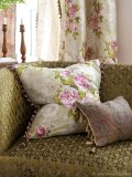As if plucked from the Queen's garden, this plush silk pillow with intricate embroidery belongs to Designers Guild's Royal Collection Campanula Fabric, seen here in Gallica Rose – Rose. Photo By Designers Guild / ©James Merrell