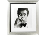 6. Black-and-white photo of Roger Moore